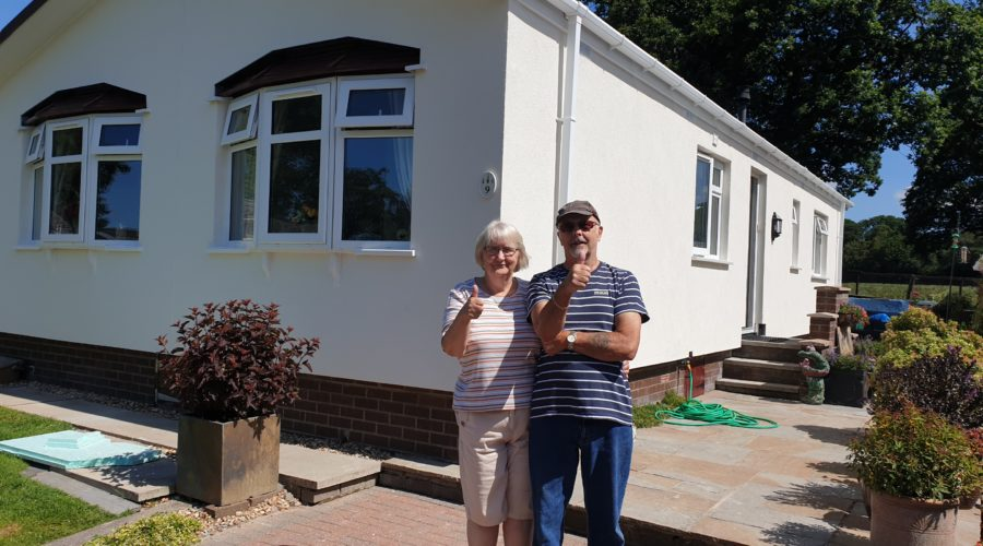 Happy customers enjoying their warmer home- 01228 812 867